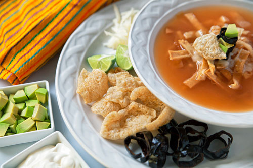 The Tortilla Soup served with many ingredients
